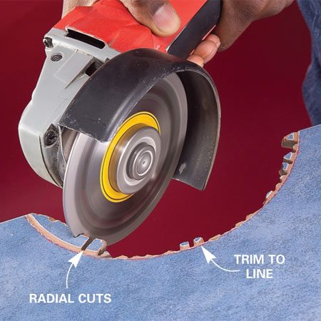 <b>Photo 2: Trim and grind</b></br> Make a series of closely spaced cuts up to the scored line. Break off the waste. Then grind the edges smooth.