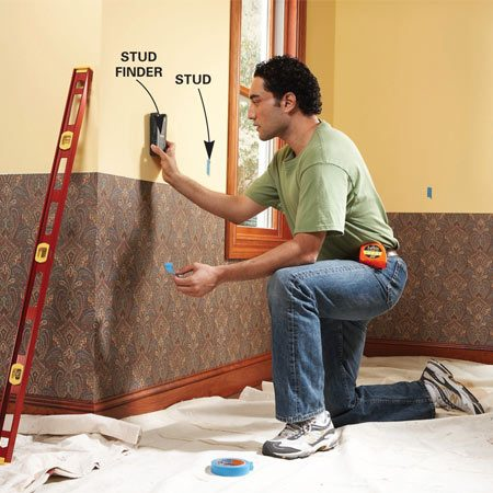 <b>Photo 1: Mark studs</b></br> <p>Locate studs and mark them with masking tape. If new wallpaper or paint is part of the project, complete those jobs before you install chair rail.</p>