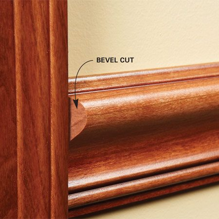 Cut a shallow bevel at the end when you install thick chair rail against thin casing.