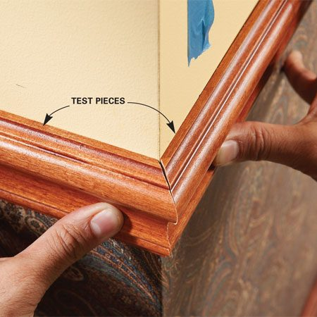 Makes test cuts in outside corners of chair rail to find the right angle.
