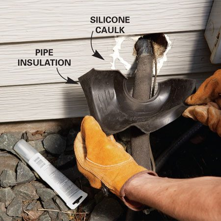 <b>Photo 3: Mount the boot</b></br> Fit the plumbing boot over the pipes, then glue it to the siding with 100 percent silicone caulk.