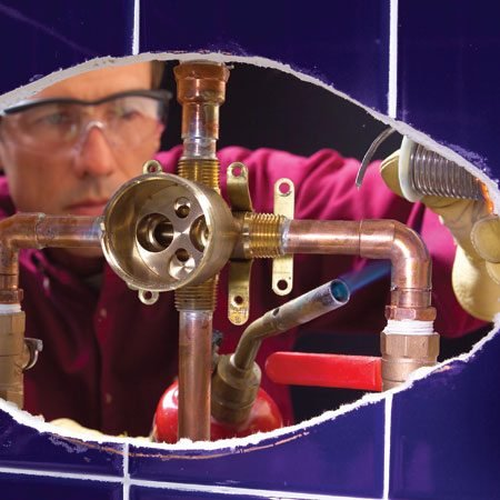 <b>Photo 2: Install the new valve</b></br> <p>Solder in the new valve. Use the paper template to make sure the valve is centered in the cutout.</p>