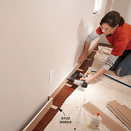<b>Photo 5: Nail base and ceiling first</b></br> Nail the base and ceiling rails to studs. Splice rails over studs.