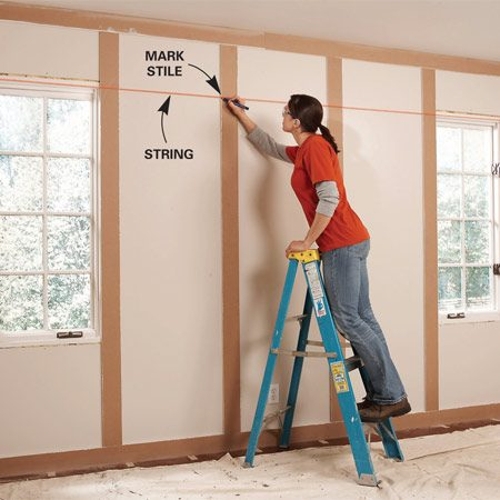 <b>Photo 8: Install rails</b></br> Mark the position of the rails above and below the windows. Use a string to align the marks with the windows.