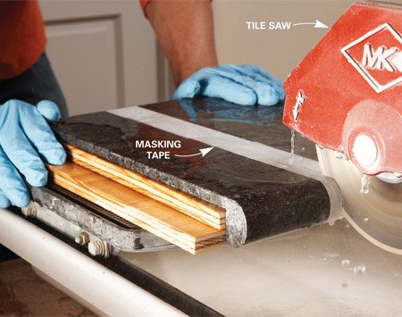 <b>Photo 2: Support tiles when cutting</b></br> Set bullnose tiles on scraps of plywood to cut them. Granite is difficult to mark clearly, so stick on some masking tape and mark the tape.