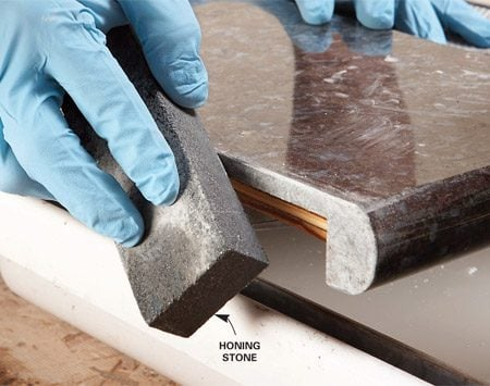 <b>Photo 3: Smooth cut edges</b></br> Rub cut edges with a honing stone to bevel the edge slightly. Rub in a circular motion to avoid wearing a groove in the stone.
