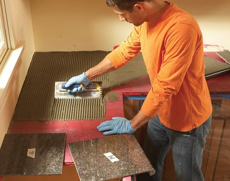 <b>Photo 6: Set tile in sections</b></br> Work in small sections, spreading just enough thin-set to set eight tiles. That gives you plenty of time to set and adjust tiles before the thin-set becomes too stiff.