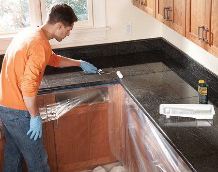 <b>Photo 11: Seal the countertop</b></br> Seal the tiles with a penetrating stone sealer after the grout has dried. A foam paint roller applies the sealer quickly and evenly.