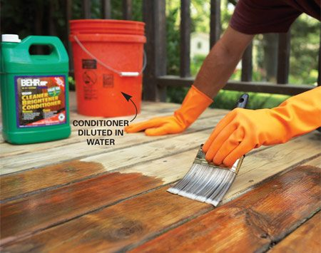 <b>Photo 3: Condition</b></br> Brush on a brightener/conditioner diluted in water. Scrub the decking and rinse thoroughly to restore the original wood color.