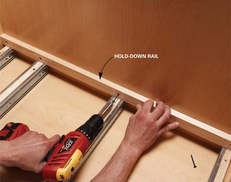 <b>Photo 7: Add the hold-down rail</b></br> Predrill and screw the cleats to the cabinet. Use plywood scraps the same width as the boxes for perfect spacing.