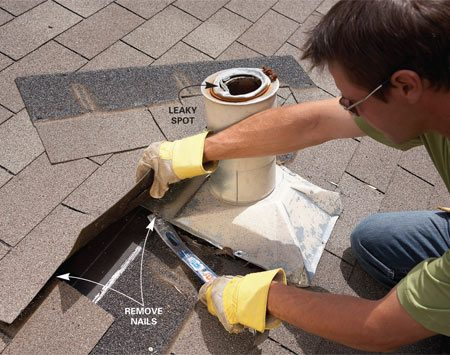 <b>Photo 1: Pry up shingles</b></br> Remove one or two shingles above the vent flashing, then pry out the vent, being careful not to damage the shingles.