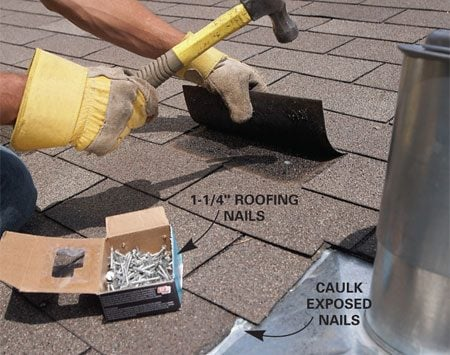 <b>Photo 3: Renail shingles</b></br> Slide the shingles that were removed back into place and renail.