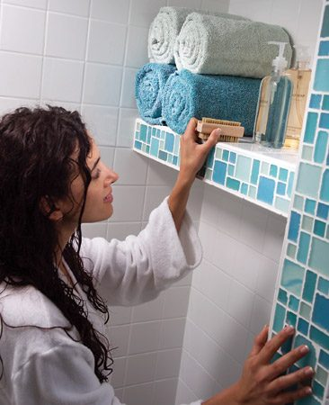 <b>Shelf</b></br> Keep shower supplies and towels dry and close at hand, just where you need them.