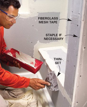 <b>Photo 3: Tape seams</b></br> Cover all seams and corners with fiberglass mesh tape. Embed the tape with a thin layer of thin-set.