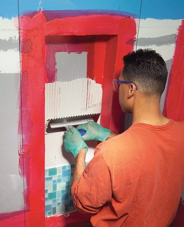 <b>Photo 5: Alcove</b></br> Spread thin-set on the back of the alcove with a 1/4-in. notched trowel and then embed the mosaic tile into the adhesive.