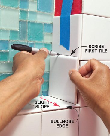 <b>Photo 9: Scribe bottom tiles</b></br> Tile the alcove bottom shelf first, sloping it slightly toward the shower. Scribe the bottom side tiles to get the proper angle, and then finish tiling the sides and top.