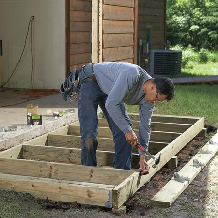 <b>A simple foundation</b></br> There's no need to pour concrete. Get off the ground with a simple treated-wood foundation. Build it just like a deck platform.