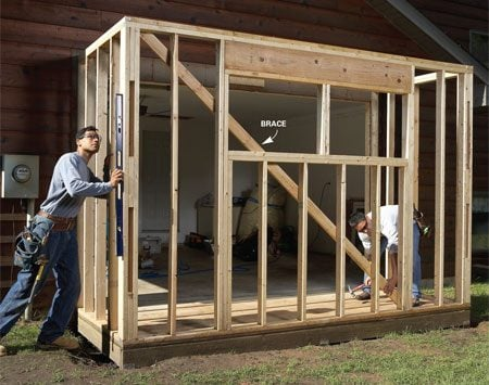 <b>Photo 7: Add the walls</b><br/>Build the walls on a flat surface like the garage floor. Stand them up on the bump-out floor and nail them to the floor and to the garage wall. Plumb and brace the front wall before installing the sheathing.