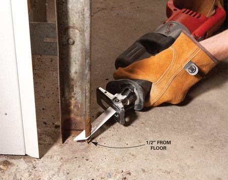 <b>Photo 1: Trim the rusty end</b></br> Mark the bottom of the track, then cut the metal with a reciprocating saw or hacksaw.