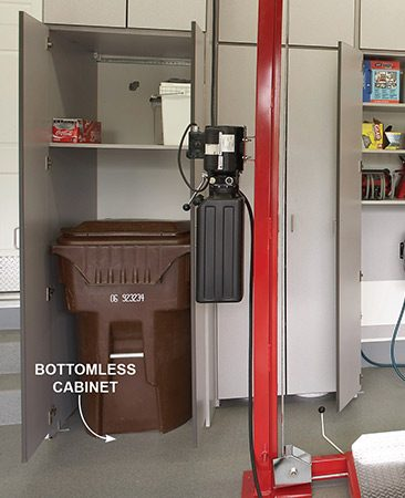 <b>Cabinet storage</b></br> The custom-made bottomless base cabinets allow trash bins to roll in and out easily.