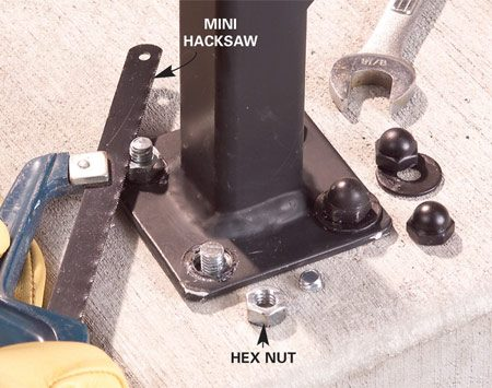 <b>Photo 9: Trim the bolts</b></br> Saw the bolts flush to the top of the hex nuts with a hacksaw. Then remove the hex nuts.