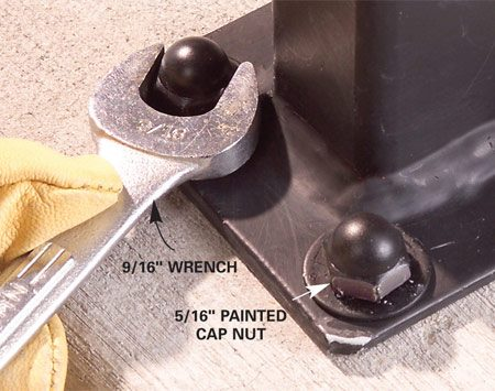 <b>Photo 10: Install cap nuts</b></br> Thread cap nuts onto the bolts and tighten them.
