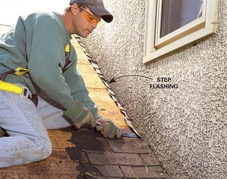 <b>Photo 7: Work around step flashing</b></br> Pull nails from any step flashing you want to save, bend it up slightly and pull out the shingles from underneath.