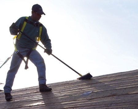 <b>Photo 11: Clean off the roof</b></br> Sweep the roof clean to avoid slips and falls. Watch for any nails you missed earlier and pull them.