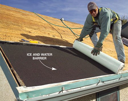 <b>Photo 12: Cover the roof</b></br> Cover the roof right away to protect against rain. Cover the lower end with self-stick ice and water barrier. Then staple down roofing felt to protect the rest of the roof.