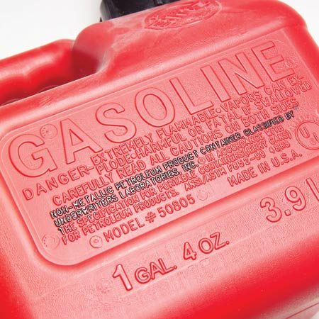 <b>Close-up of label</b><br/>The label includes a warning as well as a container approval for gasoline use.