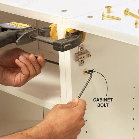 <b>Photo 4: Install cabinet bolts</b></br> Lock adjoining cabinets together with cabinet bolts.