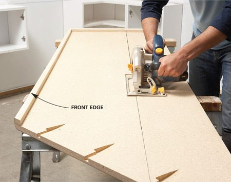 <b>Photo 5: Trim the countertops</b></br> Cut countertops to width with the laminate side down to avoid chips and scratches.