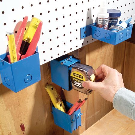 <b>Hang electrical junction boxes</b></br> Electrical junction boxes can hold a lot more than wiring. You can nail or screw them to just about anything anywhere. In the shop, they're great for those tools that can't hang on hooks—tape measures, markers, chisels, etc. Plastic boxes come in various sizes and shapes and cost 75¢ to $3 each.