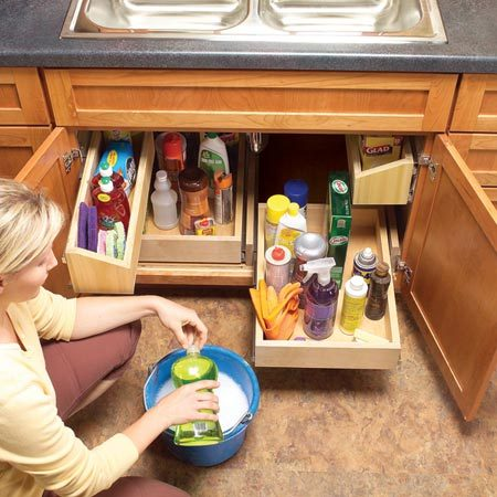 "<b>Install rollout shelves</b></br> Lower cabinets offer the biggest storage spaces in your kitchen. But the back half of cabinets is usually wasted—it's filled with forgotten stuff or left empty because it's out of sight and out of reach. Rollout shelves reclaim that space. You can buy rollouts or build your own. <a href=""http://www.familyhandyman.com/kitchen/storage/organize-kitchen-storage-with-kitchen-cabinet-rollouts/view-all"">Learn how to build your own rollout shelves</a>."
