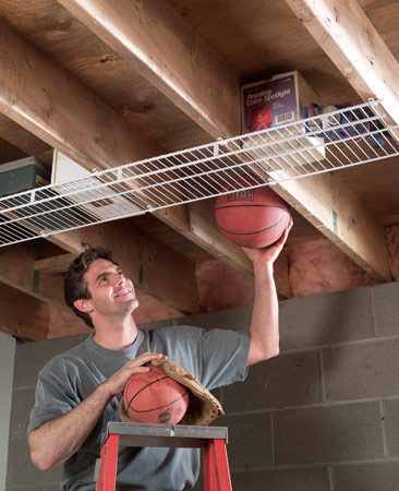 <b>Use ceiling joist space for storage</b></br> For about $2 per ft., you can turn ceiling joist space into storage space with wire shelving, though we discovered that this is a bad place to store basketballs.