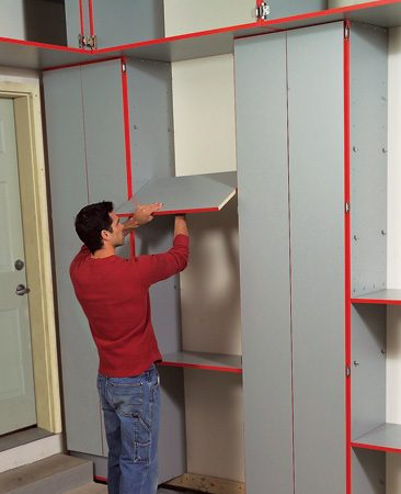 "<b>Leave space between cabinets for shelves</b></br> Whether you're building utility cabinets or buying them, you can double the storage you get from each cabinet. Just leave spaces between the cabinets and fill those spaces with shelves. The easiest way to hang the shelves is to drill holes for shelf supports in the cabinet sides. To see how to build a variety of cabinet systems, go to <a href='http://www.familyhandyman.com'>familyhandyman.com</a>. and select ""garage storage."""