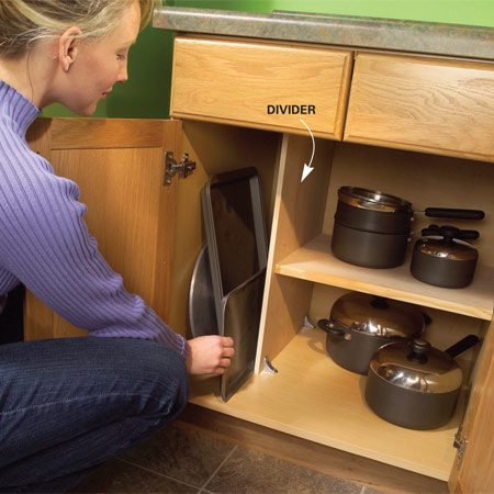 <b>Add vertical shelves for flat storage</b></br> Every kitchen needs a slot for flat cookware like cookie sheets and pizza pans. The simplest way to create these slots is to add extra shelves spaced a few inches apart. Since most cabinets have adjustable shelves, you just have to pick up a bag of shelf supports at a home center ($3) and cut new shelves from plywood or particleboard. Or make a vertical niche like  the one shown here. Just add a plywood divider, drill holes for shelf supports and shorten the existing adjustable shelf.