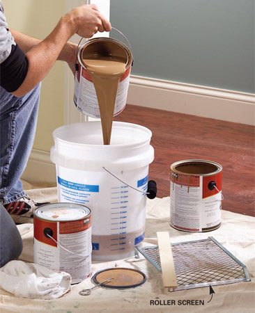 <b>Don't use paint roller trays</b></br> Forget about paint roller trays. They're inconvenient and easy to kick over or step in. Instead, pour all of the paint you need for the entire room into a 5-gallon bucket and stir the paint together. This ensures a consistent color throughout the room. If you switch gallons in the middle of a wall, the paint may look different—even if the color is made the same at the paint store. Hang a $2 roller screen in the bucket to use with your paint roller.