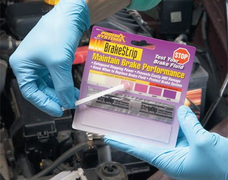 "<b>Photo 2: Compare colors</b></br> Compare the test strip with the color chart to determine the condition of the fluid. Replace your brake fluid if the color of the strip falls in the ""required service"" category."