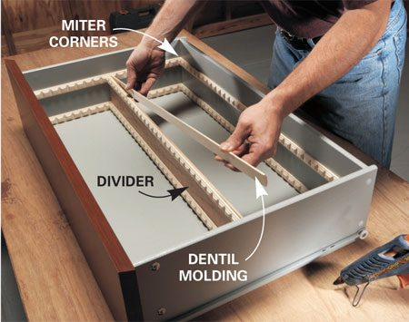 <b>Install dentil molding</b><br/>Glue dentil molding around the inside of the drawer and slip in dividers. Use additional molding to divide the space further.