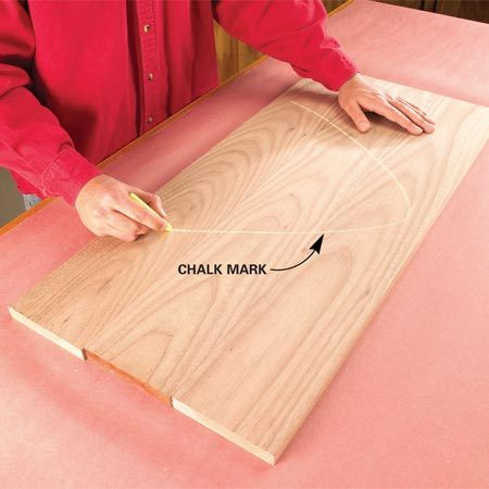"""<b>Mark the boards</b></br> Arrange boards for their best appearance. Then chalk a """"V"""" across them so you can easily align them later."""