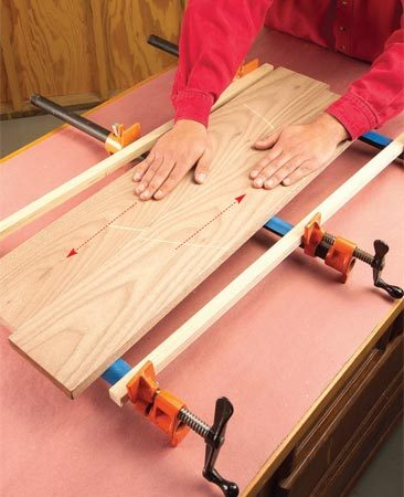 <b>Slide the boards together</b></br> Mate the boards and slide their edges together to spread the glue evenly.