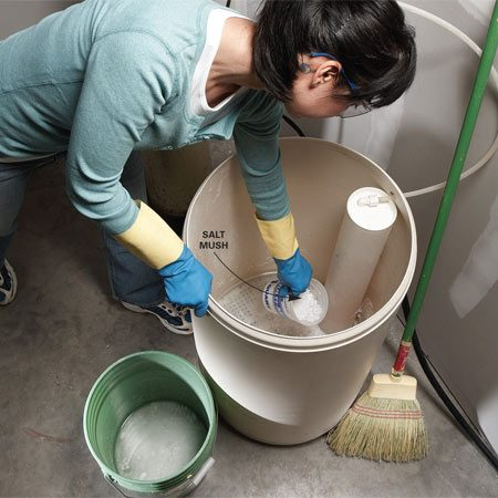<b>Remove salt mush</b></br> Scoop out the mush at the bottom of the tank, then pour in hot water to dissolve the rest before regenerating the system.