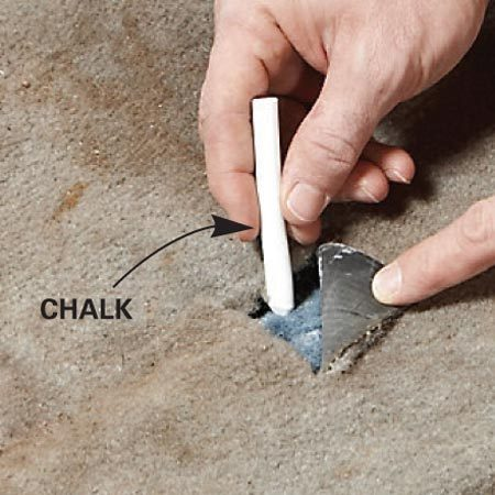 <b>Close-up of marking</b></br> Mark the openings on the new carpet with chalk.
