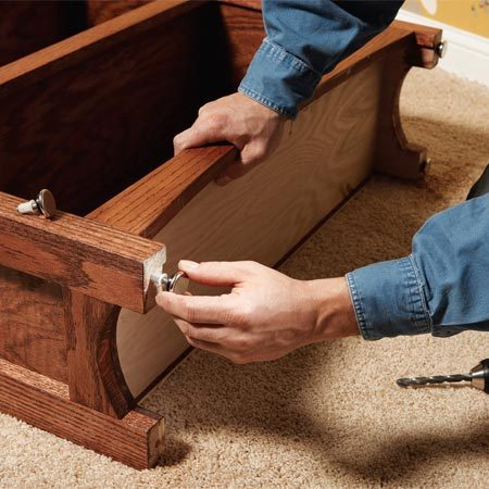 <b>Option 2: Adjustable feet</b></br> Drill holes and install adjustable feet on the bookcase corners to level it from front to back and side to side.