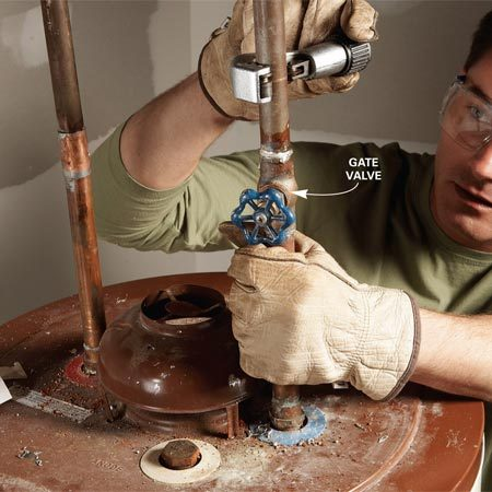 <b>Photo 3: Cut the cold water line</b></br> Cut the cold water line above the old gate valve to make room for a new ball valve. Cut the hot water line at the same height.