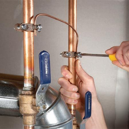 Attach bonding clamps to the hot and cold lines going<br/> to your water heater. Then connect a cable<br/> to the clamps.