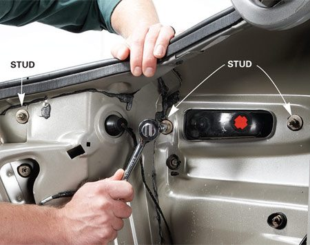 <b>Photo 1: Remove the nuts</b></br> Locate the nuts and remove them from the threaded studs using a deep socket and ratchet.