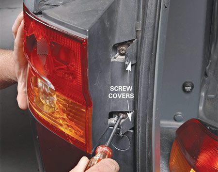 <b>Photo 1: Remove the assembly screws</b></br> Remove the screws from the trunk or lift-gate side of the taillight. These were hidden under covers.
