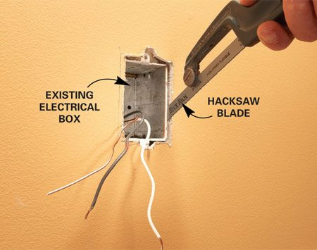 Photo 1: Cut the nails that fasten the box to the stud<br/> with a hacksaw blade. Pull out the box and loosen<br/> the clamps that hold the wire.